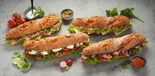 Assorted Sub Sandwiches With Ham And Cheese And Vegetables