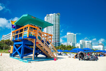 MIAMI BEACH, FL - FEBRUARY 14, 2016: Tourists And Locals Enjoy A Day At The Beach