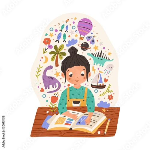 Fototapeta Sweet girl sitting at desk with scrapbook or reading fairy tale book. Kid with creative imagination. Happy child making notes in whimsical notebook. Colored flat vector illustration isolated on white obraz