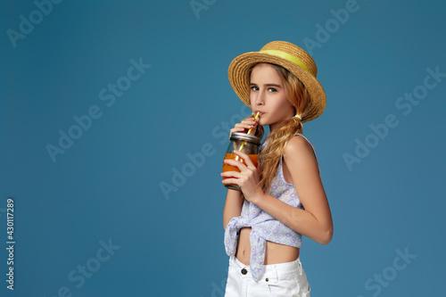 Portrait of cute little child girl drinking orange juice Wallpaper Mural