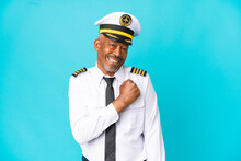 Airplane Pilot Senior Man Isolated On Blue Background Celebrating A Victory