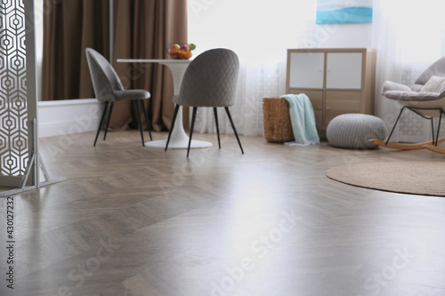 Fotografia, Obraz Modern living room with parquet floor and stylish furniture