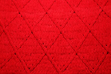 Red Woolen Fabric With Geometrical Pattern As Background, Top View
