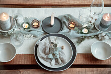 Festive Table Setting In Vintage Style With Candles And Dried Flowers.