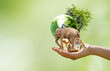 Leinwandbild Motiv Earth Day or World Animal Day concept. Saving planet, protect wildlife nature reserve, protection of endangered species, biological diversity. Elephant, tiger, deer, parrot and tree with globe in hand