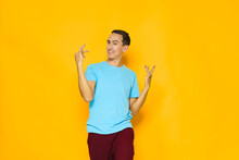 Man Blue T-shirt Gesturing With Hands Emotions Yellow Background