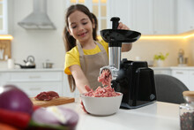 Little Girl Using Modern Meat Grinder In Kitchen