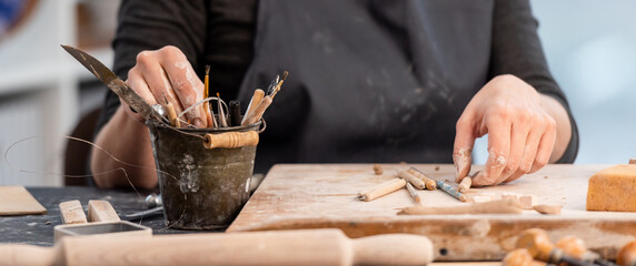 Working process of pottery with tools