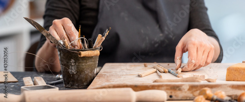 Obraz Working process of pottery with tools - fototapety do salonu