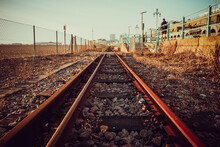 Selective Focus Shot Of Railroad On A Sunny Day