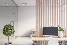 Sunny Stylish Office Hall With Wooden Slatted Partition Between Rows Of Work Places, Glass Transparent Wall, Modern Computers And Wooden Tables