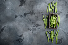 Fresh Green French Beans, In Wooden Box, On Gray Stone Background, Top View Flat Lay, With Copy Space For Text