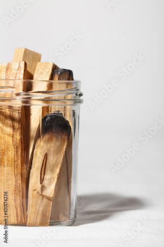 Fototapeta Palo santo holy wood sticks on white background. Spiritual practices concept obraz