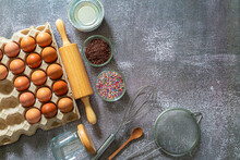 Baking Ingredients For Making Cake, Pastry Or Sweet Bread On Textured Blue Background. Cooking Ingredients Top View