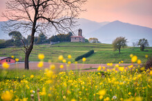 Landscape At Spring With Yellow Flowers And A Little Old Church