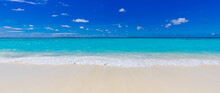 Closeup Of Sand On Beach And Blue Summer Sky. Panoramic Beach Landscape. Empty Tropical Beach And Seascape. Vacation Coast, Shore Blue Sky, Soft Sand, Calmness, Tranquil Relaxing Sunlight, Summer Mood
