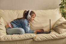 Girl With Headphones Looking Video Lesson Teacher Conference Laptop Sitting