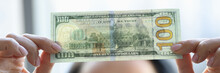 Woman Holding Dollar Bill And Looking At It With Watermarks Closeup