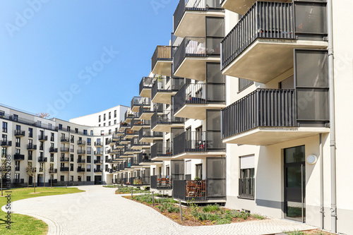 Fototapeta Cityscape of a residential area with modern apartment buildings, new sustainable