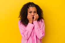 Young African American Woman Isolated On Yellow Background Biting Fingernails, Nervous And Very Anxious.