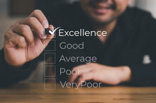 Customer Service Satisfaction Survey, Excellent Customer Service Evaluation, Businessman Hand Putting Check Mark A Checkbox On Excellent For A Satisfaction Survey.