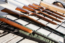 Bolt Action Rifles Laid Out In A Row On Table Ready For Use