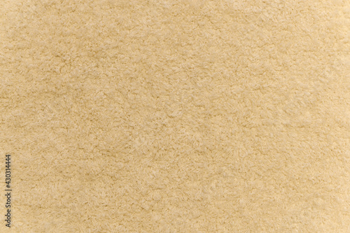 Obraz Close up of yellow carpet. Top view of texture of white foot scraper. background. - fototapety do salonu