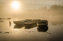 Novi Sad, Serbia - October 22, 2015: A Small Natural Lake Near The City Of Novi Sad. Wooden Fishing Boats Moored On The Shores Of The Lake, Illuminated By The First Morning Sun.
