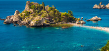 Crystal Clear Blue Green Waters Surrounding The Little Island Of Isola Bella In Taormina, Sicily. Panorama, Copy Space