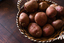 Closeup Shot Of A Basket With A Pile Of Red Potatoes