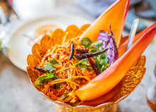 Closeup Shot Of A Thai Banana Blossom Salad Served In A Golden Vintage Bowl