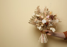 Woman Holding Beautiful Dried Flower Bouquet On Beige Background, Closeup. Space For Text