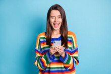 Portrait Of Attractive Cheerful Flirty Girl Using Device Browse Comment Like Winking Isolated Over Bright Blue Color Background