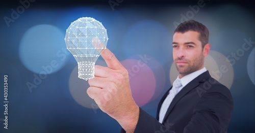 Composition of businessman touching virtual screen with light bulb of connections