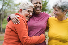 Multiracial Senior Women Having Fun Together Hugging Each Others - Main Focus On Right Female Face