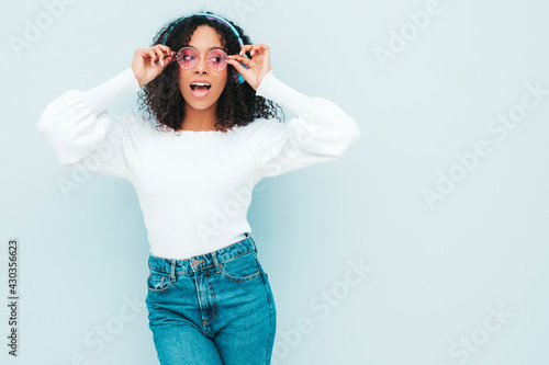Valokuva Beautiful black woman with afro curls hairstyle
