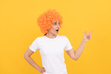 Look Over There. Amazed Fancy Party Look. Freaky Woman In Clown Wig Pointing Finger, Copy Space