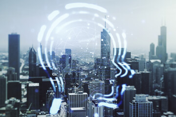 Abstract virtual artificial Intelligence interface with human head hologram on Chicago skyline background. Multiexposure