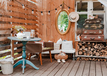 Interior Of The Summer Country Cozy Wooden Rustic Terrace With Vintage Accessories Furniture. Atmospheric Interior Room For Summer Vacation In The Country.