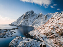Aerial View Of A Scenic Road Along The Coastline In Wintertime Near Ramberg Townscape, Lofoten Islands, Norway.