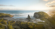 Panoramic Aerial View Of Coastal Beach And Seaside Rock Formations At Golden Hour In Torres, Rio Grande Do Sul, Brazil.
