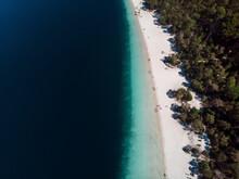 Aerial View Of People Sunbathing At Lake McKenzie On Fraser Island, Queensland, Australia.