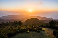 Aerial View Of A Man Watching The Sunrise, Chão Das Feiteiras, Madeira Island, Portugal.