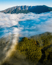 Aerial View Clouds Between Mountains And Forest In La Palma Island, Canary Islands, Spain.