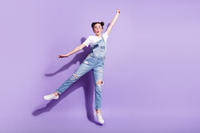 Full Body Photo Of Young Excited Girl Jump Up Try To Catch Umbrella Isolated Over Violet Color Background