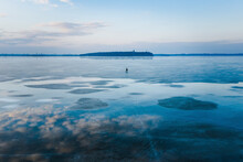 Aerial View Of Fisherman Walking On The Frozen Lake In Spring Time, Kaunas, Lithuania.