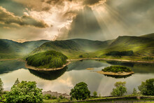 Sun Rays Bursting Through Storm Clouds, The Lake District, Cumbria, England
