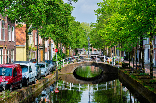 Canvas Print Cars on canal embankment in street of Delft. Delft, Netherlands