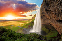 Rainbow Over The Waterfall