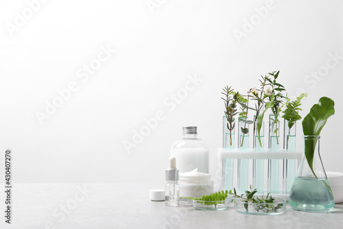 Obraz Organic cosmetic product, natural ingredients and laboratory glassware on white table, space for text - fototapety do salonu